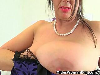 British milf Lulu fondles her big tits..