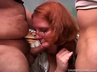 Cute chubby redhead sucks two..