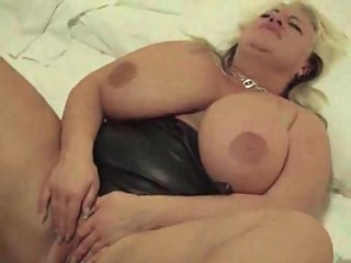 Masstive Titted MILF has her Big tits..